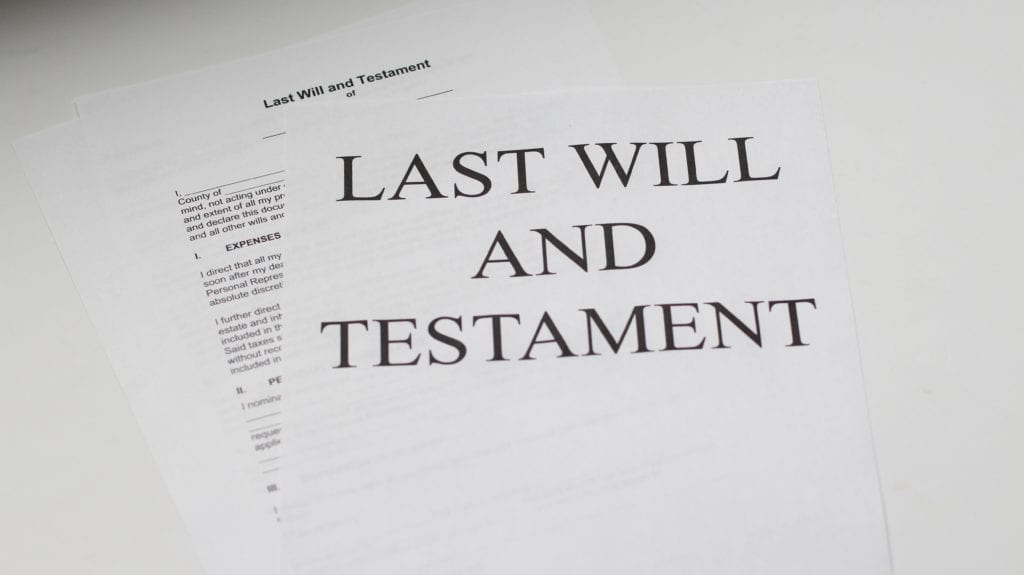 A legal document on a table. Wills and trusts are both legal documents dealing with the distribution of assets.